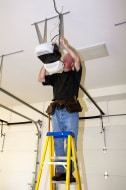 Garage Doors Are Us - Garage Door Specialist Installing Garage Close and Opener